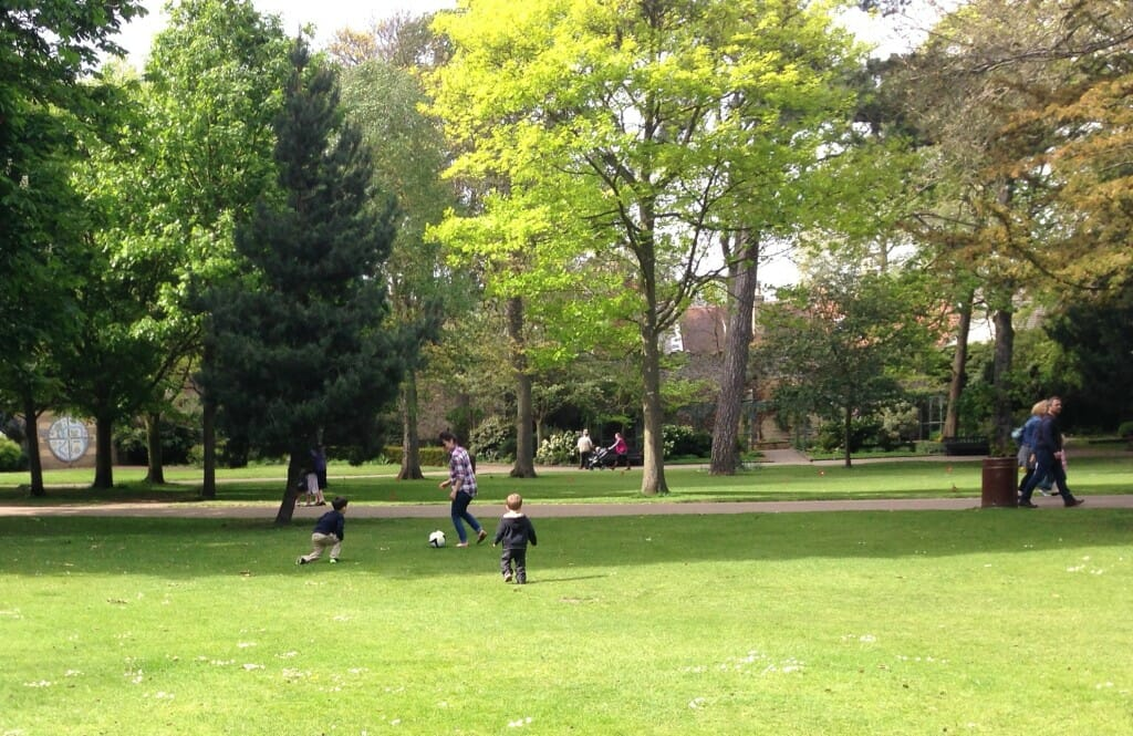 Formal gardens share space with pick-up games of soccer
